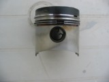 Piston from a Yanmar 3GM30 diesel